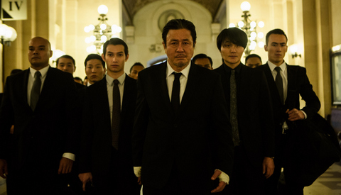 """Jessica Forde/Universal Studios The merciless Mr. Jang (Choi Min-Sik) assembles his thugs in """"Lucy."""""""
