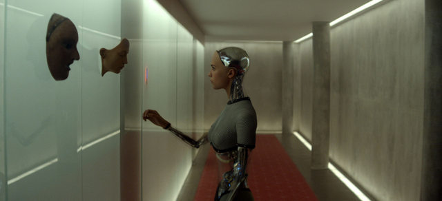 Ex Machina - Alicia Vikander as Ava at wall of faces