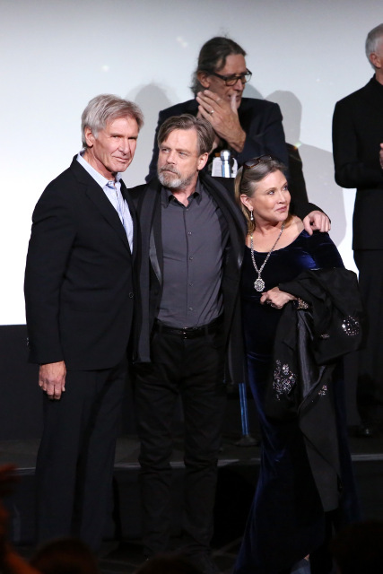 """HOLLYWOOD, CA - DECEMBER 14:  (L-R) Actors Harrison Ford, Mark Hamill and Carrie Fisher attend the World Premiere of """"Star Wars: The Force Awakens"""" at the Dolby, El Capitan, and TCL Theatres on December 14, 2015 in Hollywood, California.  (Photo by Jesse Grant/Getty Images for Disney) *** Local Caption *** Harrison Ford;Mark Hamill;Carrie Fisher"""