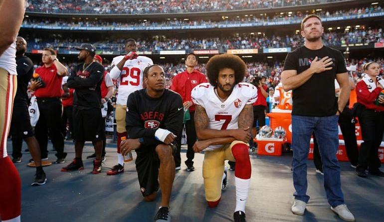 49ers-colin-kaepernick-and-eric-reid-kneeling