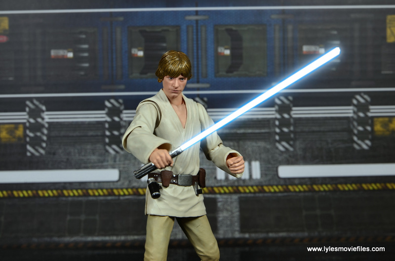 SH Figuarts Luke Skywalker figure review -lifting up lightsaber lit